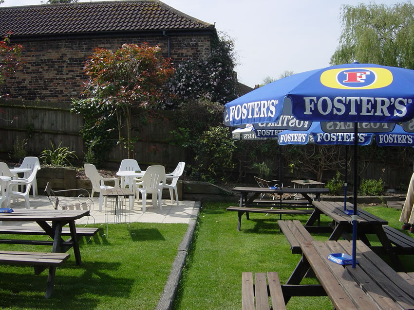 Seating and tables in Riverside Lawn Garden - The Old Crown Public House Weybridge Elmbridge